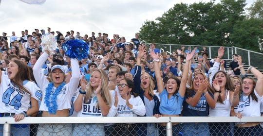 Livonia Stevenson fans celebrate their teams' first touchdown on Aug. 29, 2019.