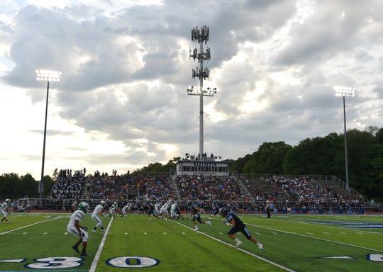 A play begins on Aug. 29 at Livonia Stevenson High during their Spartan varsity football game.