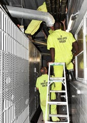 A crew of inmates performs work Friday morning on the now closed Opelousas City Jail, placing insulation on ventilation pipes. Work has been ongoing at the municipal jail complex over the last couple of months in order to reopen the facility.