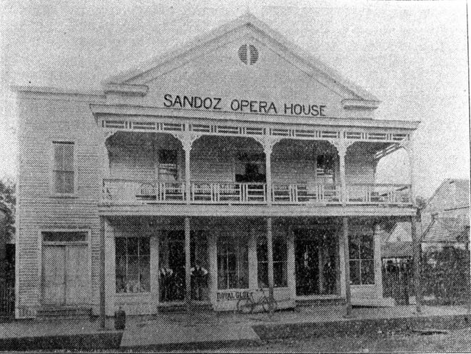 The Sandoz Opera House  on Main Street in downtown Opelousas, photo taken in 1896. This is where the hero of this story was scheduled to appear. But that never happened.