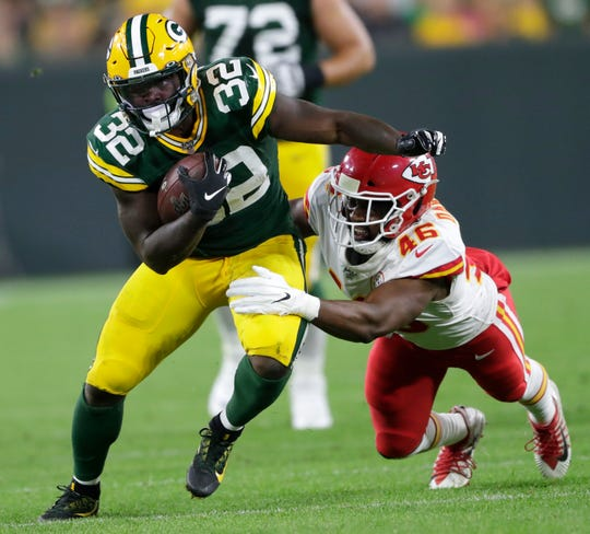 Green Bay Packers running back Tra Carson (32) runs for a gain against Kansas City Chiefs linebacker Raymond Davison (46) in the second quarter Thursday, August 29, 2019, at Lambeau Field in Green Bay, Wis. 