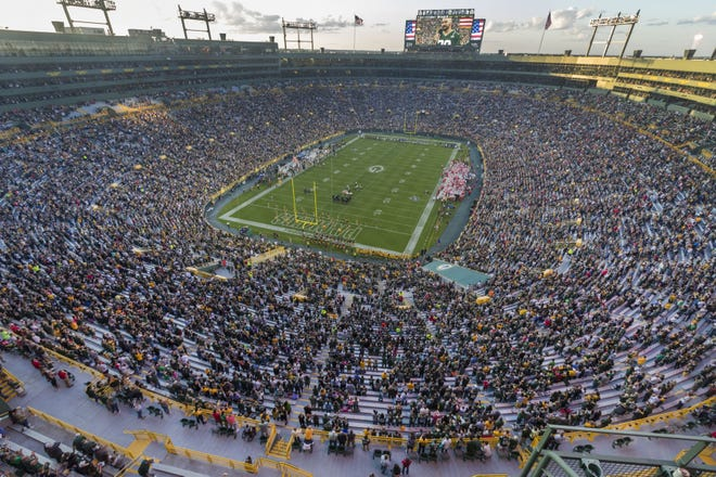 Green Bay Packers fans stand for the National Anthem before their pre-season game against the Kansas City Chiefs Thursday, August 29, 2019 at Lambeau Field in Green Bay, Wis,