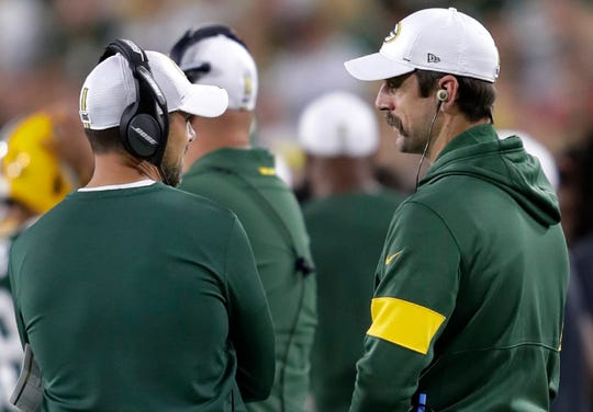 Packers coach Matt LaFleur and quarterback Aaron Rodgers, right, talk on the sideline during the Aug. 29 preseason game against the Kansas City Chiefs.