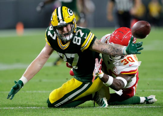 Green Bay Packers tight end Jace Sternberger (87) tries to pull down a reception against Kansas City Chiefs defensive back Harold Jones-Quartey (30) in the second quarter Thursday, August 29, 2019, at Lambeau Field in Green Bay, Wis. 