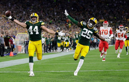 Green Bay Packers linebacker Ty Summers (44) celebrates in the endzone as he runs back an interception for a 74-yard touchdown with teammate cornerback Will Redmond (25) against the Kansas City Chiefs in the second quarter Thursday, August 29, 2019, at Lambeau Field in Green Bay, Wis. 