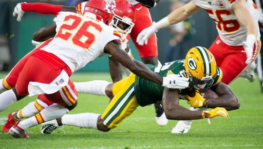 Green Bay Packers wide receiver J'Mon Moore (82) dives with the ball during the first quarter as the Green Bay Packers host the Kansas City Chiefs for their last preseason game of the year on Thursday, August 29, 2019.