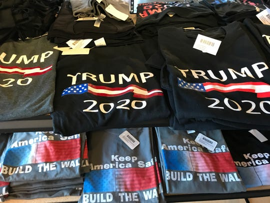 "Some items at Trump Ville are campaign oriented, and others are incendiary, like these ""Build the Wall"" T-shirts seen on August 29, 2019."