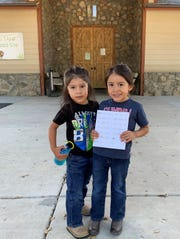 Brothers Leonard Martinez, a Cahuilla Band of Indians tribal member, left and Marvin Martinez, a Santa Rosa Band of Cahuilla Indians tribal member, display quarters they collected for the Santa Rosa tribe's park.