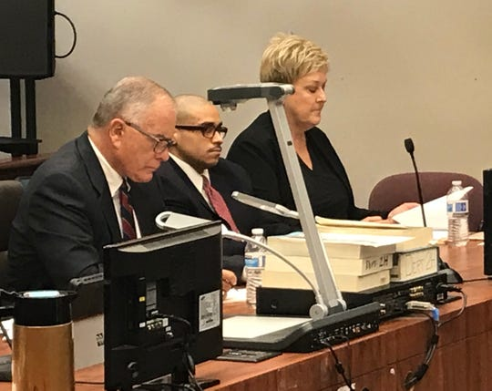 John Hernandez Felix, flanked by his attorneys, John Patrick Dolan, left, and Kelli McDowell, before sentencing is handed down by Judge Anthony Villalobos.