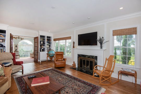 The living area features a fireplace and overlooks Bayview Park.