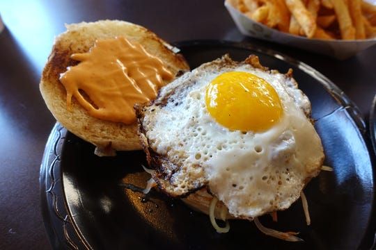 Longsilog bun with longanisa patty, pickled atchara, spicy mayo and fried egg at Deez Buns in Tempe.