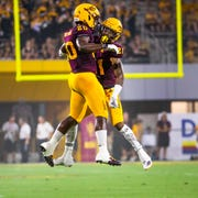 Arizona State University linebacker Khaylan Kearse-Thomas chest butts defensive back Jack Jones after Jones made a great play against Kent State University at Sun Devil Stadium, Thursday, August 29, 2019.