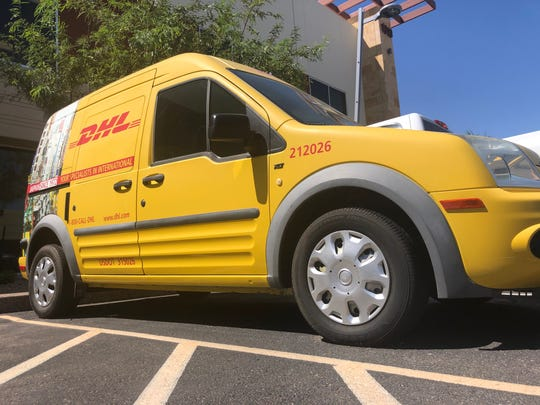 A DHL van sits outside of the DHL Express customer service hub in Tempe on Friday, August 30.