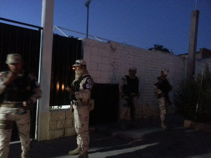 National Guard troops surround the entrance to the migrant shelter in Agua Prieta, Sonora, on June 23, 2019, in an unsuccessful attempt to conduct an immigration inspection.