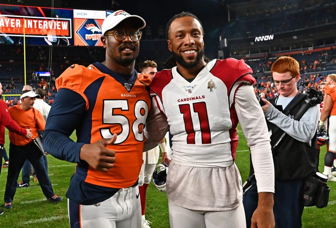 Aug 29, 2019; Denver, CO, USA; Arizona Cardinals wide receiver Larry Fitzgerald (11) and Denver Broncos outside linebacker Von Miller (58) pose for a photo following the preseason game at Broncos Stadium at Mile High.