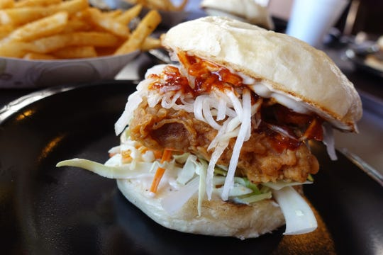 K.F.C. bun with house-made chicken nugget, pickled radish, slaw, house spread and fire sauce at Deez Buns in Tempe.
