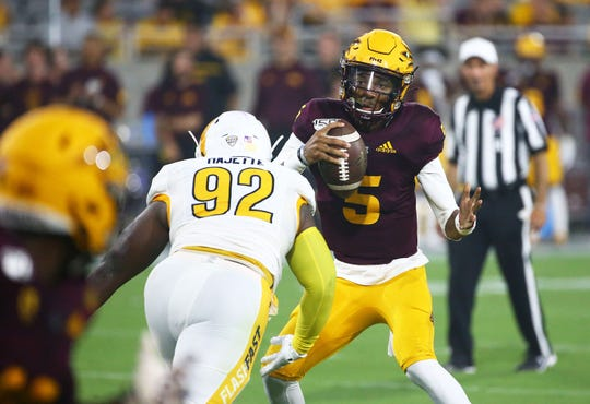 Arizona State quarterback Jayden Daniels (5) is sacked by Kent State Golden Flashes defensive lineman Theo Majette (92) in the first half during a game at Sun Devil Stadium on Aug. 29, 2019 in Tempe, Ariz.