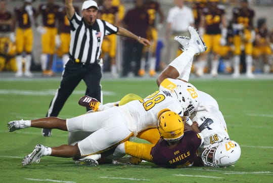 Arizona State quarterback Jayden Daniels is sacked by Kent State in the first half during a game at Sun Devil Stadium on Aug. 29, 2019 in Tempe, Ariz.