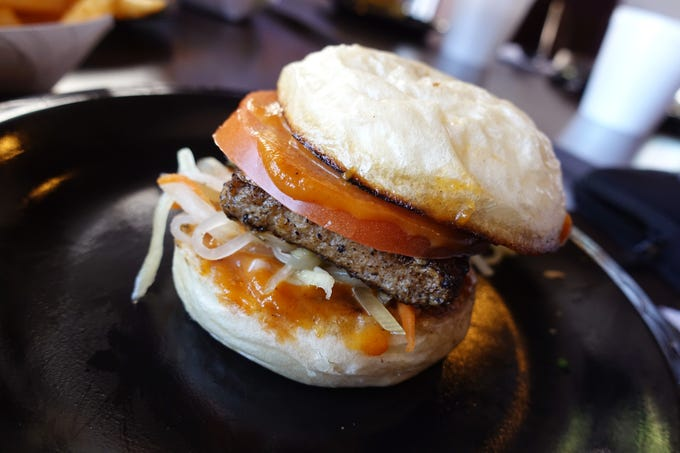 Satay bun with chicken patty, spicy peanut sauce, tomato and atchara at Deez Buns in Tempe.