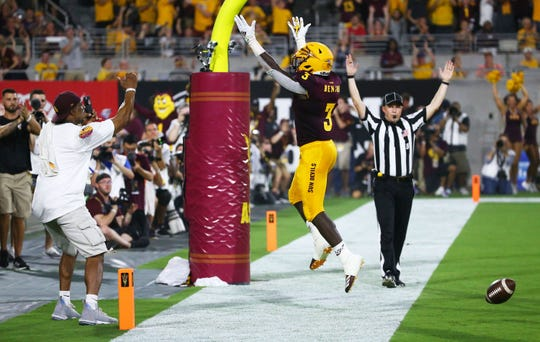 Arizona State Sun Devils quarterback Jayden Daniels throws a touchdown pass to running back Eno Benjamin (3) against Kent State in the first half during a game at Sun Devil Stadium on Aug. 29, 2019 in Tempe, Ariz.