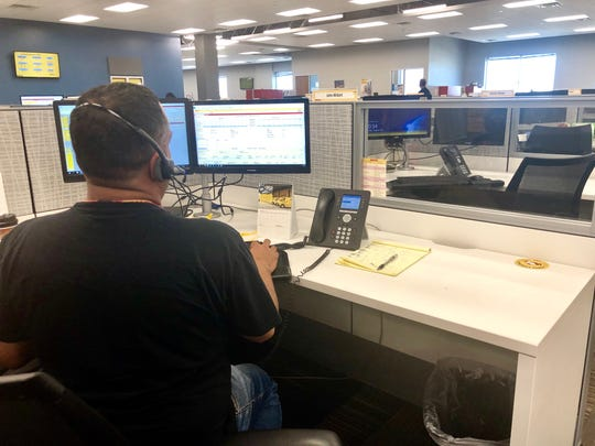 A DHL Express customer service agent in Tempe works at his desk on Aug. 30, 2019.