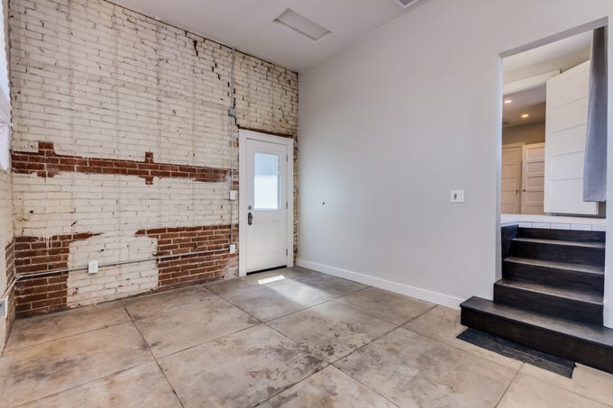 """The 3,162-square-foot brick house, built by Phoenix's first civil engineer, in the neo-classical revival style has five bedrooms and four bathrooms, has been """"lovingly restored"""" since then and plans to add a two-car garage, pool and pool house have been approved by the city."""
