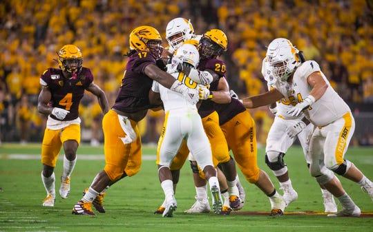 The Arizona State University defense stacks up Kent State University running back Xavier Williams during the second quarter at Sun Devil Stadium, Thursday, August 29, 2019.