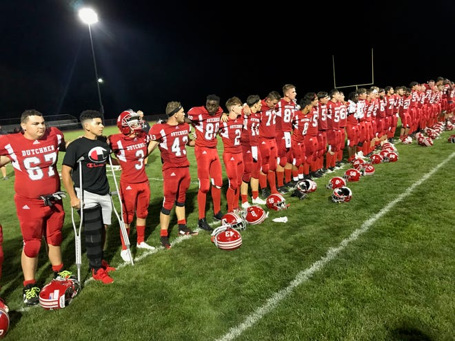 The Annville-Cleona football team lines up to sing the alma mater after Thursday night's 34-7 win against Octorara.