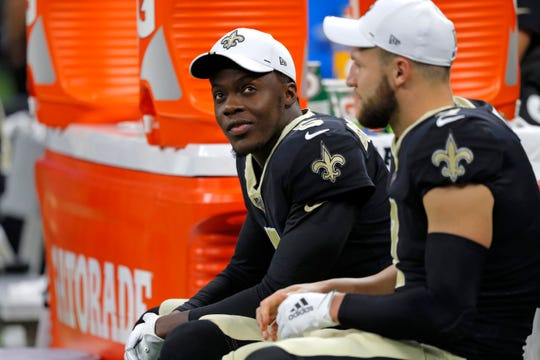 New Orleans Saints quarterbacks Teddy Bridgewater, left, and Taysom Hill sit on the bench in the first half of an NFL preseason football game in New Orleans, Thursday, Aug. 29, 2019. (AP Photo/Bill Feig)
