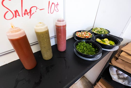Several different salsas and toppings are set out on the counter at Chef's Fresco Mexicano in Lexington, forming the restaurant's salsa bar.