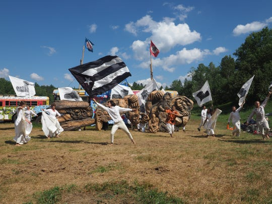 """Members of the Bread and Puppet Theater are shown in a production of the """"Grasshopper Rebellion,"""" in Glover, Vermont in 2018. The troupe will perform a free show at Fisher Center at Montgomery Place Sept. 7."""