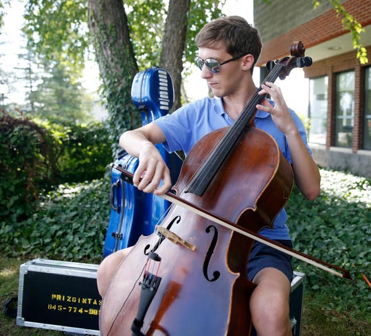 Alex Prizgintas plays his cello while at Marist College on August 29, 2019.