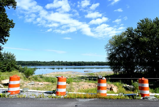 The berm on a creek overpass on River Road is lined with barriers resulting from destruction caused by flooding one year ago on Accomac Road Friday, Aug. 30, 2019. Bill Kalina photo