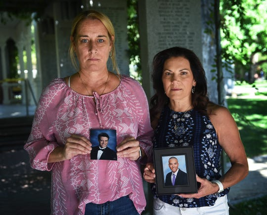 "Robyn Watts, left, and Teresa Taylor hold portraits of their sons on the campus of the University of Nevada, Reno. Jordan Watts and Robert ""Ben"" Taylor died just weeks from graduating after taking street drugs mixed with fentanyl."