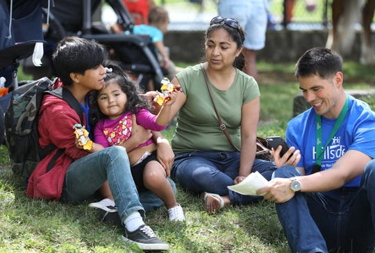 Paul Stack, a Youth Advocate at School 17 through Hillside Children's Center, works with students like Aran Rosales Reich as a mentor. Stack meet with Aran's mother, Lizbeth Reich, and 2 year old sister Mia Rivera Reich at the School 17 community open house before the school year.