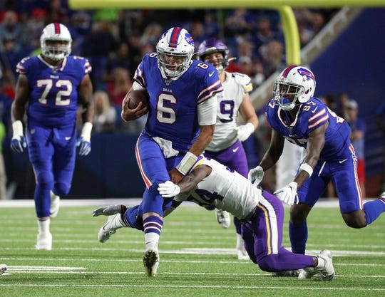 Bills rookie quarterback Tyree Jackson is tackled after a short gain against the Vikings.