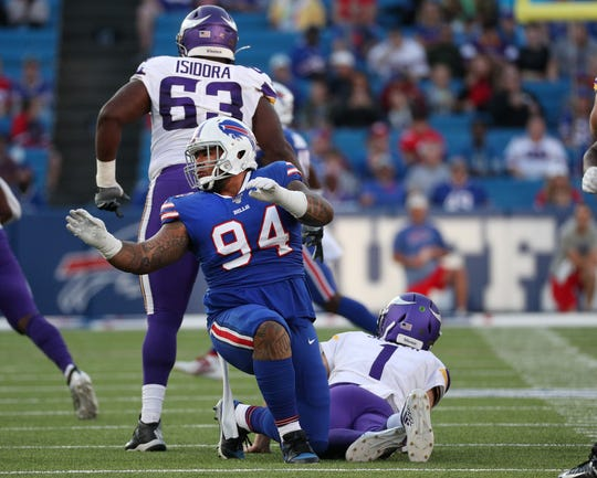Buffalo Bills defensive tackle Kyle Peko tries to follow the play after knocking down Vikings quarterback Kyle Sloter during a preseason game. Peko was promoted to the active roster this week.