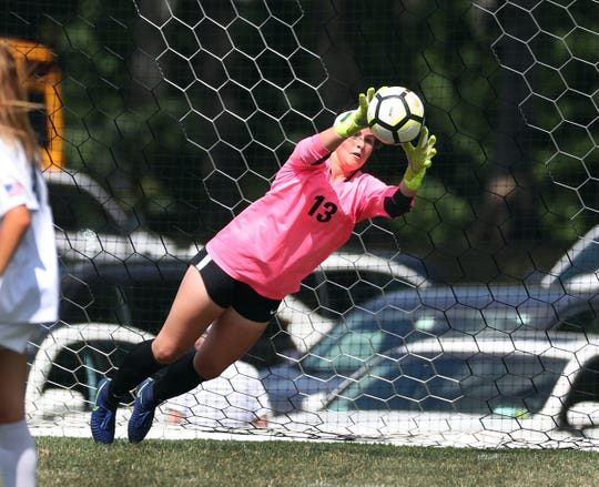 Schroeder goalie Megan Fry makes this save against Athena to help preserve a shutout in a 3-0 Webster win.