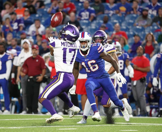 Bills Robert Foster zeros in on Minnesota punt returner Dillon Mitchell  for the tackle just as the ball is caught.