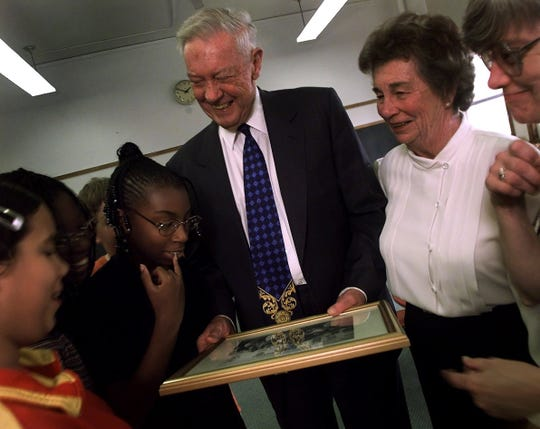 -  Robert and Peggy Wegman, center, share a laugh with sixth-graders Amanda Quinones, Mary Moore, Avis Reese and Paul Button, behind Reese, as they look at a photograph taken of the children when they were in kindergarten with the Wegmans. Looking on, far right, is Corpus Christi at Blessed Sacrament School principal Sister Eileen Daly.