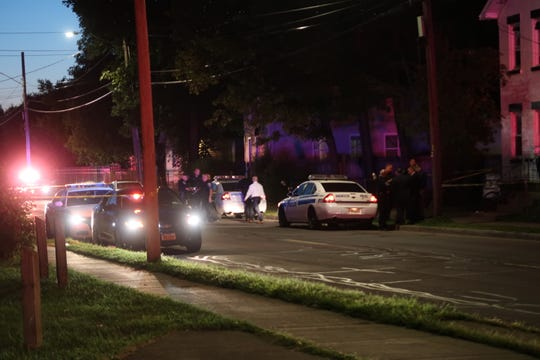 Police investigate a fatal shooting in northeast Rochester on Thursday night.