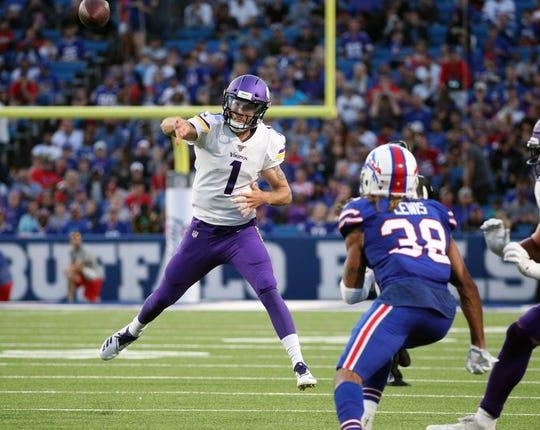 Vikings quarterback Kyle Sloter makes an off-balance throw agains the Bills.