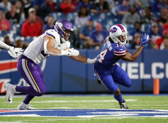 Bills receiver Ray-Ray McCloud runs past Vikings linebacker Devante Downs in a preseason game this summer.