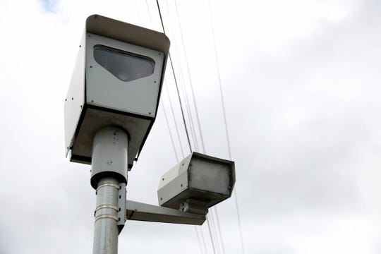 A red-light camera at the intersection of 25th and Mission St. SE. The city is adding three new red-light cameras and will upgrade speed limit enforcement for existing cameras.