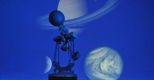 The Angelo State University Planetarium projector displays various planets on the dome.