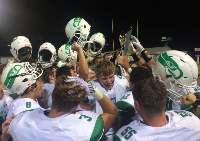The Wall football team celebrates the first win of the season after beating Mason at home Thursday, August 29, 2019.