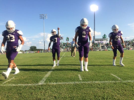The Mason Punchers warm up before their game against the Wall Hawks on Thursday, Aug. 29, 2019.
