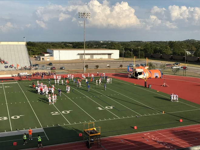 The San Angelo Central High School Bobcats gather on the field before their game Friday, Aug. 30, 2019.