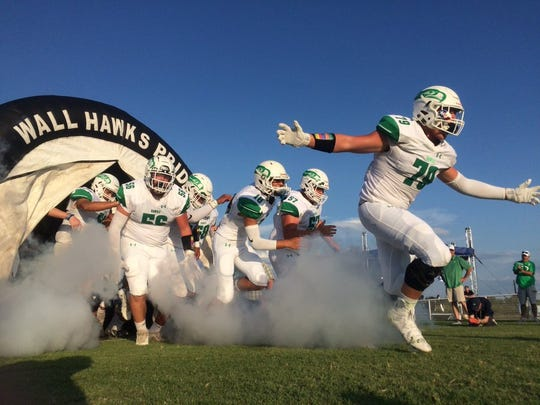 The Wall Hawks storm onto the field before their football game Thursday, Aug. 29, 2019, against the Mason Punchers in Mason.
