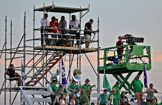 Crew members with Fox Sports Southwest sit perched high above the stands and the Wall marching band during the first game of the season in Mason on Thursday, August 29, 2019.